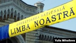 "A sign celebrates the ""Day of Romanian Language"" in Chisinau, Moldova."