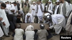 Mourners bury Kandahar City Mayor Ghulam Haidar Hamidi, one of the region's most trusted public servants, who was assassinated last month.