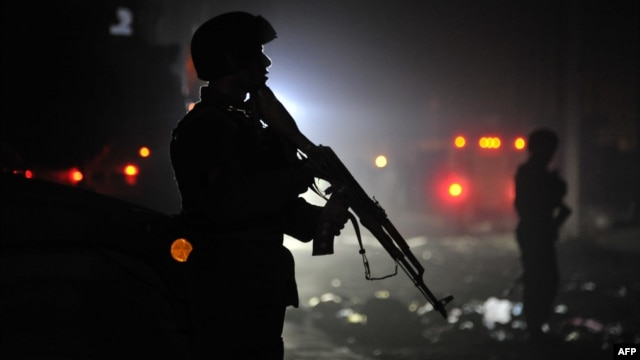 Afghan security forces at the site of a suicide attack in Kabul on October 18.