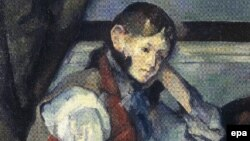 "A section of a reproduction of Paul Cezanne's painting ""The Boy in the Red Vest,"" which was stolen from a private museum in 2008."