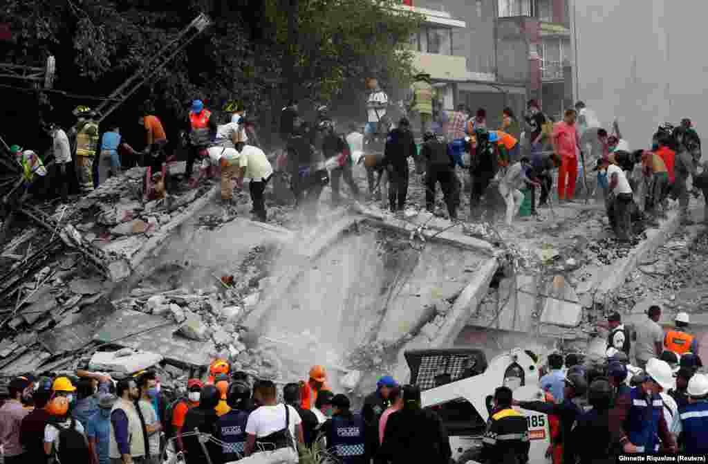 MEXICO -- Soldiers, rescuers and people work at a collapsed building after an earthquake in Mexico City, Mexico September 19, 2017