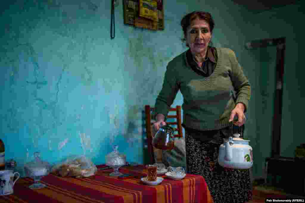 Suzanna Bakhyshova in her house on the edge of the oil field in the Binagady district of Baku. The house has no running water and no sewage system.