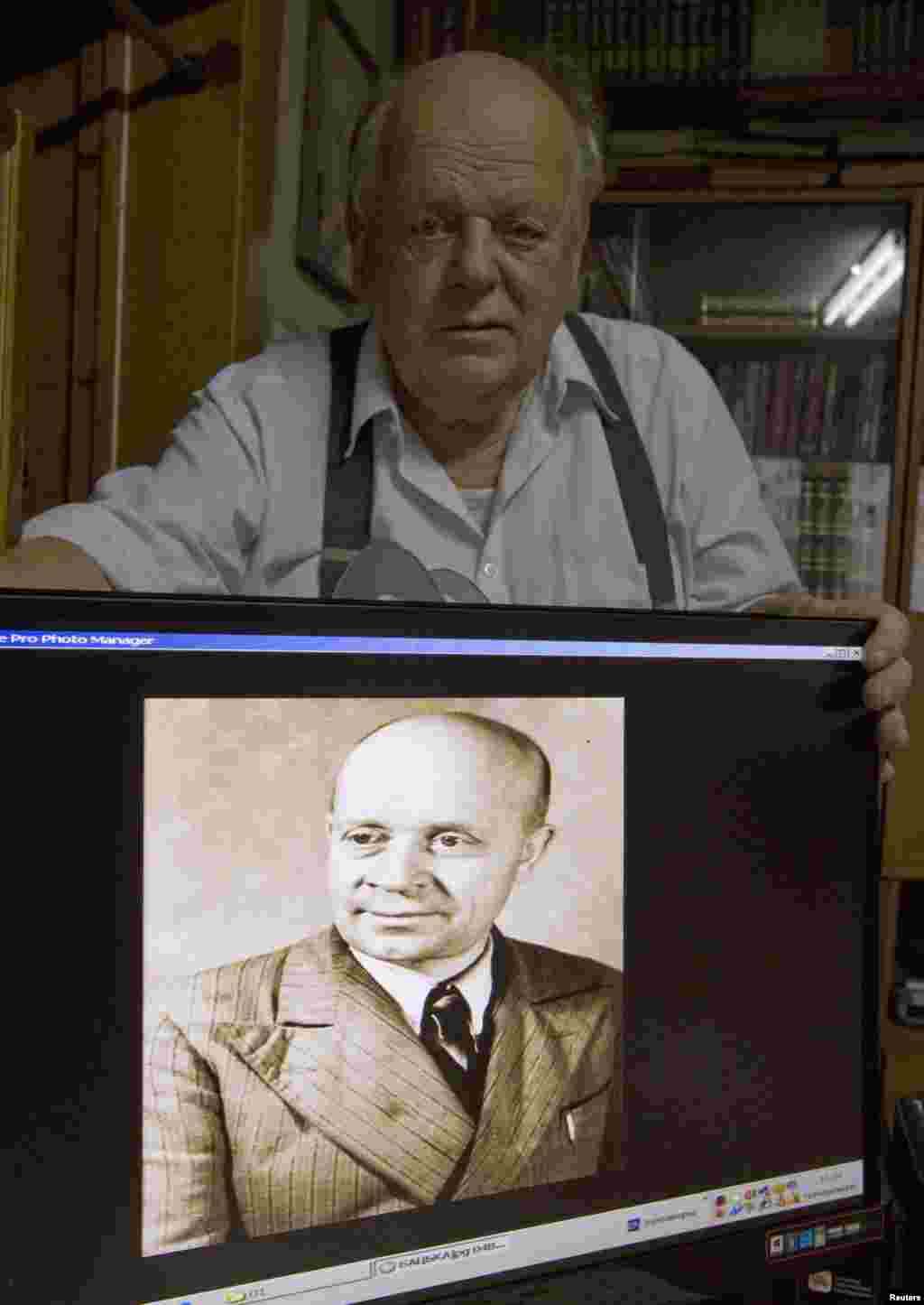 Stanislau Shushkevich, the first leader of independent Belarus, shows a portrait of his father, Stanislau, on a computer screen in Minsk. Shushkevich says his father was arrested twice, in 1936 and 1948, but survived the camps to return home.