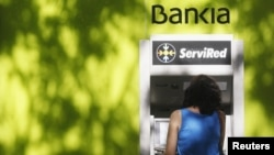 The credit ratings of 28 Spanish banks were downgraded after Spain formally requested a bailout for its banks.