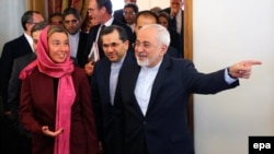 Iranian Foreign Minister Mohamad Javad Zarif (R) welcomes EU foreign policy chief Federica Mogherini (L) to Tehran, July 28, 2015
