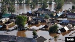 Затопленные в Иркутской области России дома. 26 июня 2019 года.