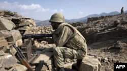 Soldiers secure a location on a hillside in South Waziristan