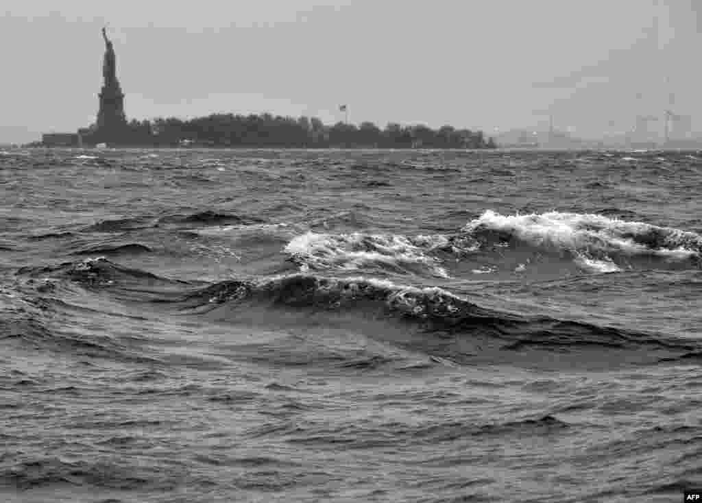 High surf on the Hudson River near the Statue of Liberty in New York