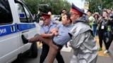 Kazakhstan President - Kazakh police detain a demonstrator in Almaty, Kazakhstan, Wednesday, June 12, 2019, during protests against presidential elections. Protests have continued in the capital, Nur-Sultan, and in Almaty, Kazakhstan's principal city. Pol