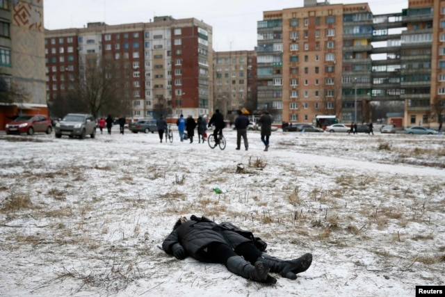 The body of a woman killed by shelling lies in a residential area in the eastern town of Kramatorsk on February 10.