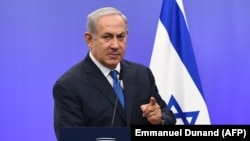 BELGIUM -- Israeli Prime Minister Benjamin Netanyahu gestures as he speaks during a joint press conference with the EU foreign policy chief, at the European Council in Brussels, December 11, 2017