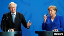 Борис Джонсон и Ангела Меркель