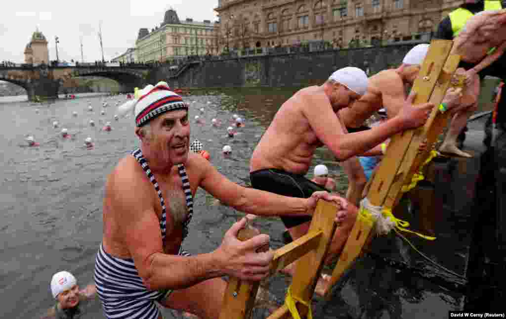 Bathers participate in the annual Christmas winter-swimming competition on the Vltava River in Prague on December 26. (Reuters/David W. Cerny)