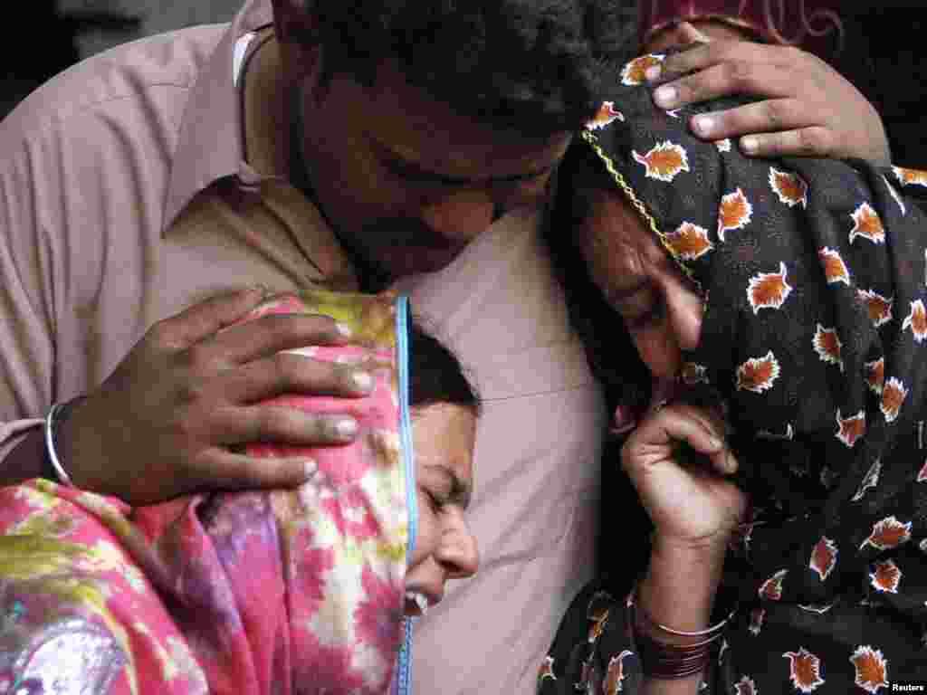 Family members grieve near the body of a man who was killed in a bomb attack at the shrine of Sufi Saint Fareed Shakar Ganj in Pak Pattan on October 25. A bomb exploded at the gate of the Sufi shrine in Pakistan's eastern city of Pak Pattan on Monday, killing six people, a city government official said. Photo by Reuters