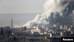 Smoke rises from the Syrian town of Kobani on October 14.