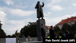 Prague 6 district representatives unveil a new explanatory text about the role of Soviet Marshal Ivan Konev at his monument in Prague on August 21, 2018.