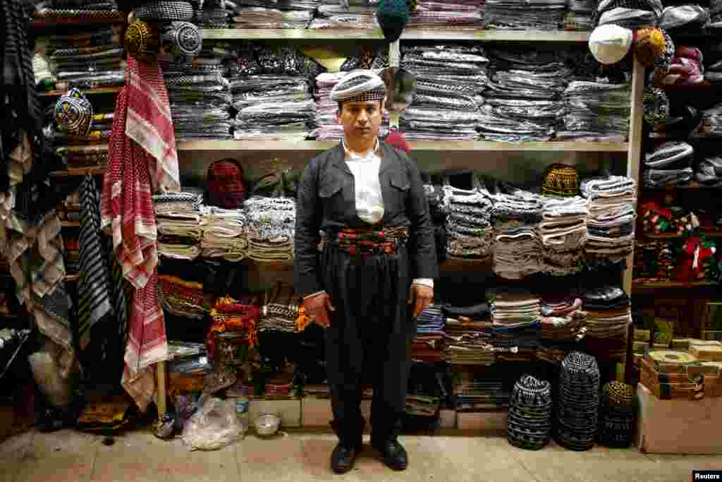 Crafts salesman Hidaya Muhyiddin, 35, poses for a photograph in Irbil, the capital of Iraq's autonomous Kurdish region. (Reuters/Azad Lashkari)
