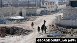 Сирійські проурядові військові поблизу району Баадін в Алеппо, який 27 листопада перейшов під контроль сил Башара Асада