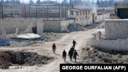 Сирийские военнослужащие на востоке города Алеппо. 23 ноября 2016 года.