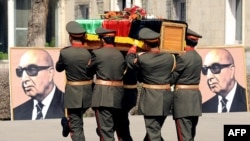 FILE: Afghan army officers carry the coffin of former President Sardar Muhammad Daud Khan in March 2009.