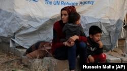 Сирийские беженцы в лагере для перемещенных лиц в Турции
