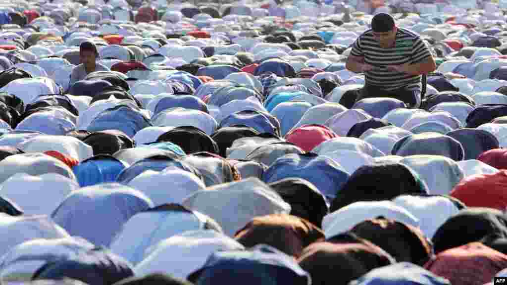 Muslims pray on the first day of Eid al-Fitr on a square in central Bishkek.