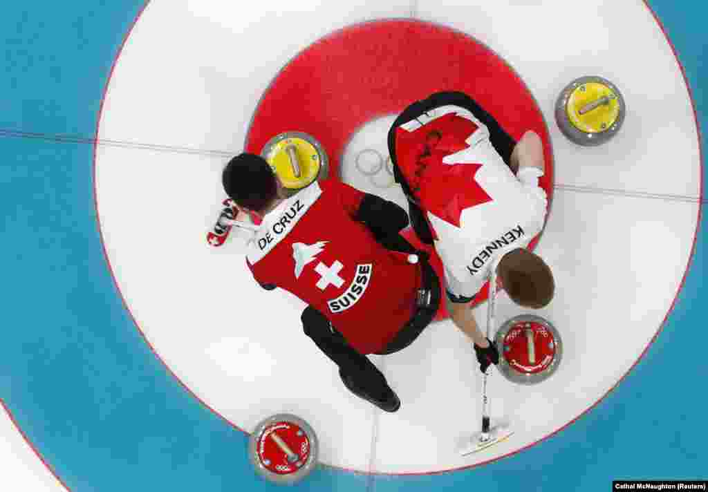 Curling: Skip Peter de Cruz of Switzerland and vice-skip Marc Kennedy of Canada sweep during the Men's Bronze Medal Match at Gangneung Curling Center during the Pyeongchang 2018 Winter Olympics, Gangneung, South Korea, February 23, 2018. Team of Switzerland won bronze with score 7:5.