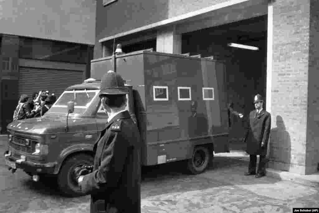 Under heavy security, a police van carries siege suspect Fowzi Badavi-Negad to the Horseferry Magistrates Court in London on May 8, 1980.