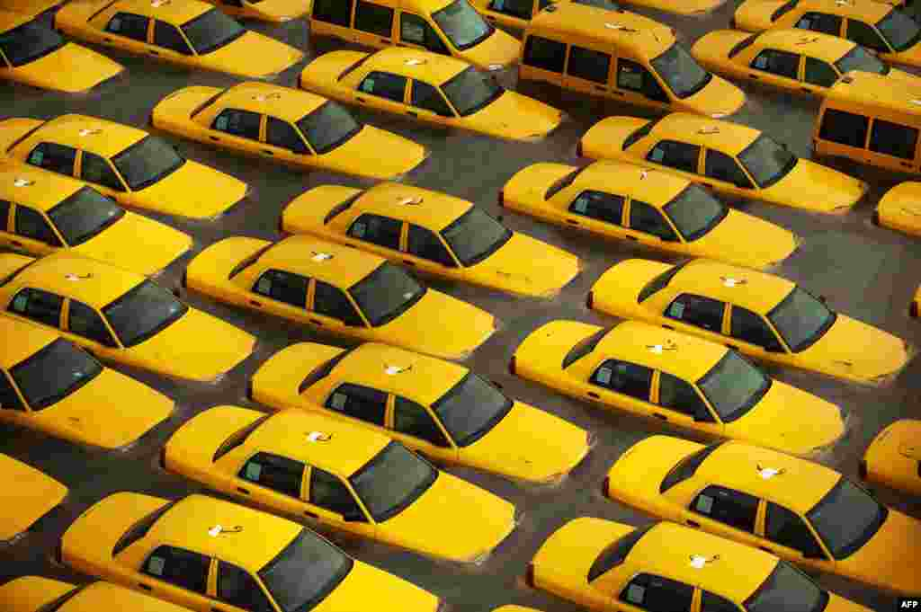OCTOBER 30, 2012 -- Taxis sit in a flooded lot after Hurricane Sandy in Hoboken, New Jersey. (Michael Bocchieri/Getty Images/AFP)