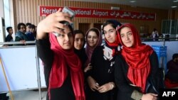 Members of the Afghan robotics team prepare to leave Herat International Airport for the United States on July 13.