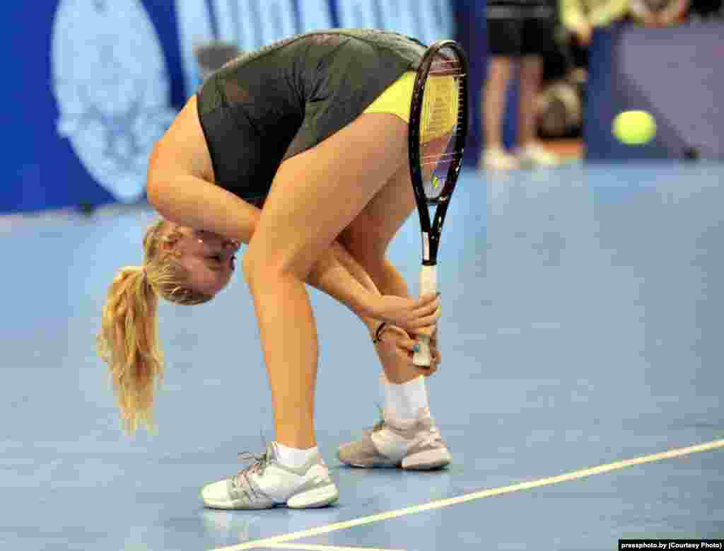 Tennis player Caroline Wozniacki of Denmark jokes around during a charity match against Belarusian tennis player Victoria Azarenka. Photo by Viktar Drachou