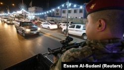 پلیس عراقی در حال گشتزنی در بغداد