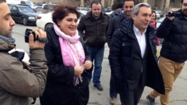 RFE/RL journalist Khadija Ismayilova en route to the Azerbaijani Prosecutor General's office on 19 Feb 2014.
