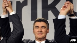 Croatia -- Main opposition leader Zoran Milanovic reaises his hands after hearing preliminary results of parliamentary elections in Zagreb, 04Dec2011
