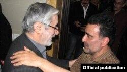 Opposition leader Mir Hossein Musavi (left) and Mostafa Tajzadeh (file photo)