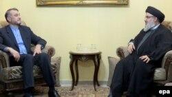 """""""Хезболланын"""" лидери Саид Хассан Насралла (оңдо) Ирандагы жолугушууда. 2015-жылы тартылган сүрөт."""