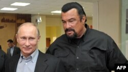 President Vladimir Putin and American action movie actor Steven Seagal visit a newly-built sports complex in Moscow, March 13, 2013