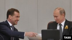 Russian President Vladimir Putin (right) with Dmitry Medvedev at a special session of the State Duma in Moscow, which confirmed the latter's appointment as prime minister.