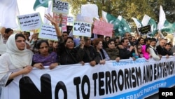 "Pakistanis attend a ""peace walk"" in the city of Lahore last month, after representatives of Pakistan and the Taliban met for the first time since the government suspended the peace process over the killing of 23 soldiers by the rebels."