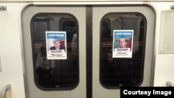 "Posters in the St. Petersburg subway calling out members of the ""Shameful Regiment."""