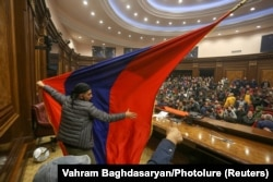 Angry protesters stormed the parliamentary assembly in Yerevan on November 10 after Prime Minister Nikol Pashinian said he had signed an agreement to end the war in Nagorno-Karabakh.
