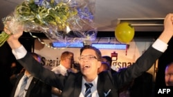 Jimmie Aakesson, leader of the far-right Sweden Democrats, celebrates after the results came in on September 19.