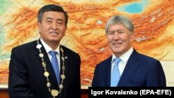 Happier times. Kyrgyz President Sooronbai Jeenbekov (left ) and former President Almazbek Atambaev at the new president's inauguration ceremony at the state residence in Bishkek.