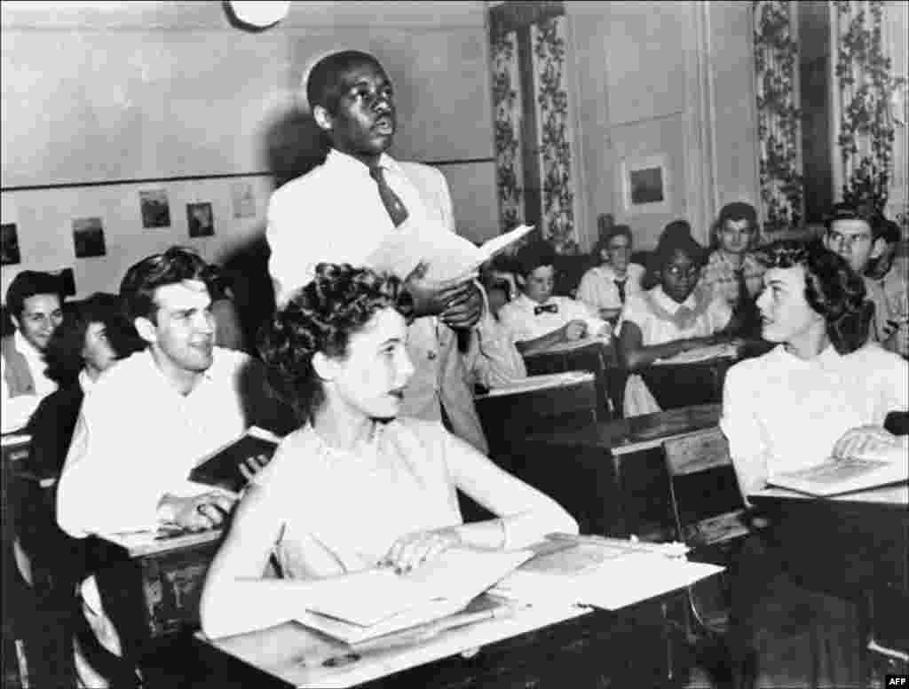 A black student, Nathaniel Steward, 17, recites his lesson on May 21, 1954, at the Saint-Dominique school in Washington, D.C. The school was among the first to hold integrated classes of black and white students following Brown v. Board of Education, the Supreme Court decision outlawing school segregation.