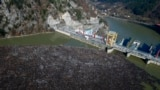 Bosnia Balkans Pollution -- This is aerial photo shows plastic bottles, wooden planks, rusty barrels and other garbage clogging the Drina river near the eastern Bosnian town of Visegrad, Bosnia, Tuesday, Jan. 5, 2021.