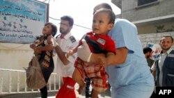 Раненые палестинские дети в секторе Газа. 1 августа 2014 года.