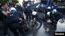 German riot police detain protesters during anticapitalist demonstrations ahead of the G20 summit in Hamburg on July 6.