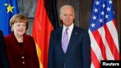 Ankela Merkel we Jo Baýden