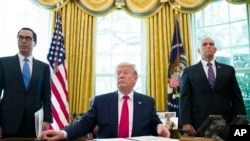 President Donald Trump listens to a reporter's question after signing an executive order to increase sanctions on Iran, in the Oval Office of the White House, Monday, June 24, 2019, in Washington. Trump is accompanied by Treasury Secretary Steve Mnuchin, left, and Vice President