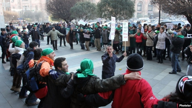 Armenia - Environmental activists demonstrate outside a government building in Yerevan against mining in Syunik, 29Dec2011.